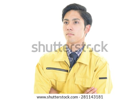 Smiling Asian worker - stock photo