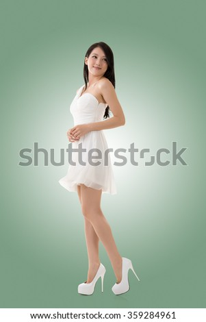 Smiling Asian young woman, full length portrait isolated. - stock photo