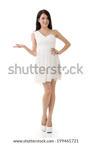 Smiling Asian young woman introduce, full length portrait isolated on white. - stock photo