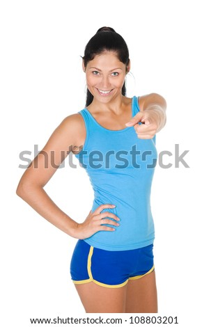smiling athletic woman pointing his finger at you. isolated on white background - stock photo