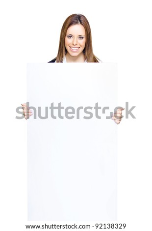 Smiling Attractive Business Woman Holding And Showing Blank Sign Or White Notice In A Product Promo And Placard Presentation, Isolated On White Background