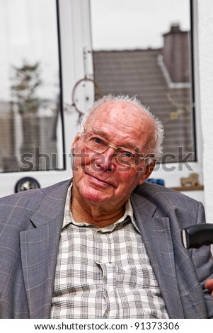 smiling attractive elderly man - stock photo
