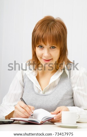 smiling attractive girl with a notebook. Office worker