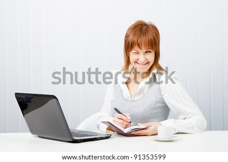 smiling attractive girl with a notebook. Office worker - stock photo
