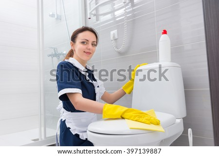 Smiling Attractive Housekeeper Housewife Wearing Neat Stock Photo - Bathroom cleaner person