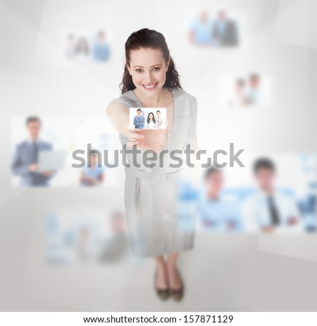 Smiling attractive woman catching a picture on blurred background - stock photo
