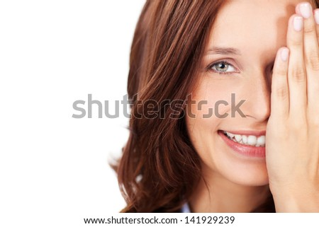 Smiling attractive woman hiding one half of her face with her hand, closeup headshot portrait on white with copyspace - stock photo