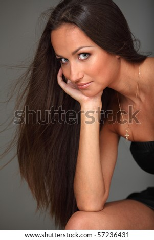 Smiling attractive young brunette - stock photo