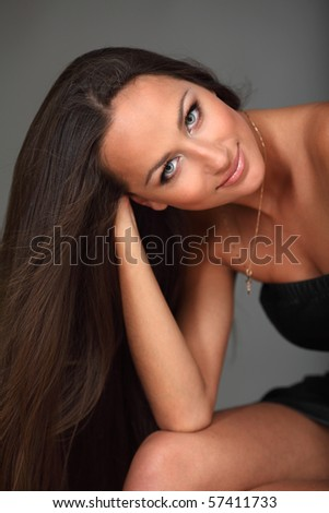 Smiling attractive young girl with long splendid hair - stock photo