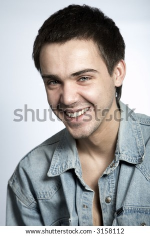 smiling attractive young man on white isolated background