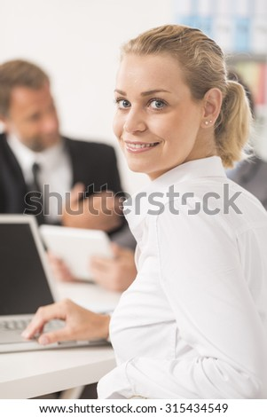 Smiling attratives businesswoman attending meeting