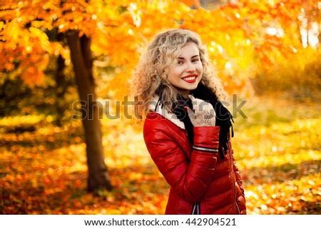 Smiling autumn woman with red lips - stock photo