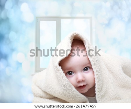 Smiling baby boy after shower - stock photo