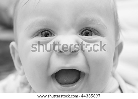 Smiling baby boy closeup portrait with soft focus - stock photo