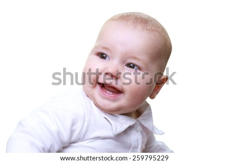 Smiling baby boy looking at camera  - stock photo