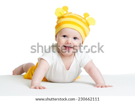 smiling baby boy weared funny hat lying on belly - stock photo