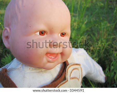 Smiling baby doll - stock photo