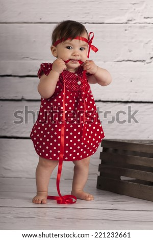 Smiling Baby Girl in red dress  - stock photo