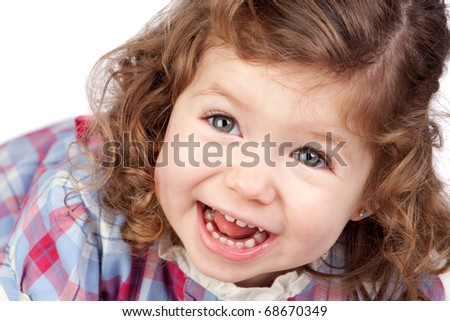 Smiling baby girl isolated over white background