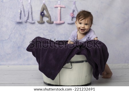 Smiling Baby Girl near basket - stock photo