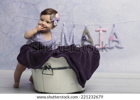 Smiling Baby Girl near tub - stock photo