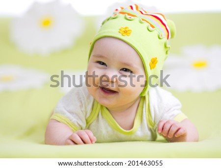smiling baby girl over flower background - stock photo