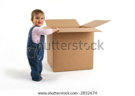 smiling baby girl thinking outside the box - stock photo
