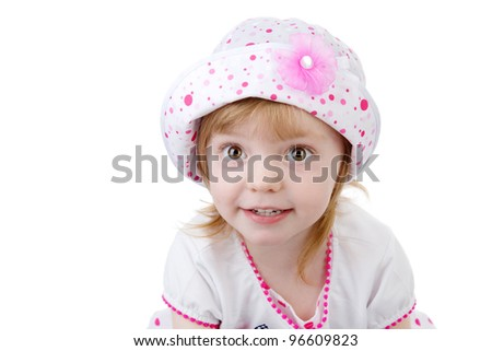 Smiling baby girl wearing a hat with a flower. isolated on white background