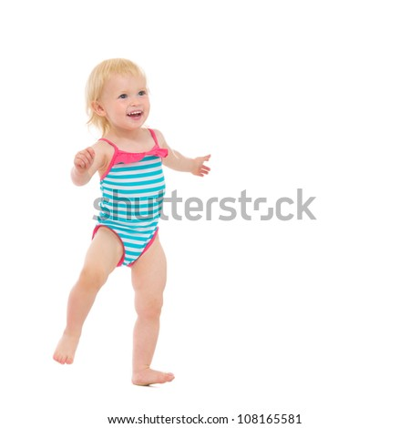 Smiling baby in swimsuit dancing - stock photo