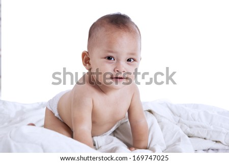 Smiling baby looking at camera - shot in the studio - stock photo