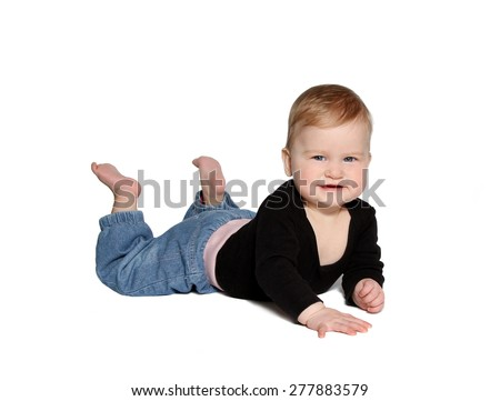 smiling baby lying down looking at camera on white background - stock photo