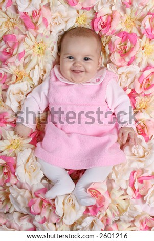Smiling Baby on Flower Blanket - stock photo