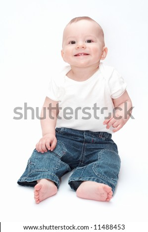 smiling baby sitting on the floor - stock photo