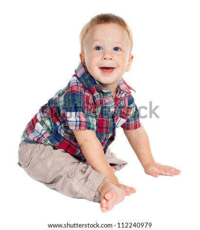 Smiling baby sitting on the floor, isolated on white - stock photo