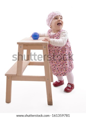 smiling baby to have gotten his feet. Isolated over white. - stock photo