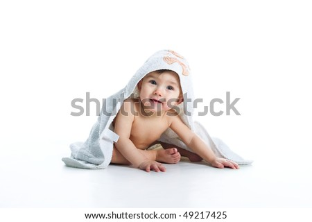 Smiling baby under towel on white background - stock photo
