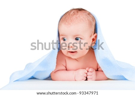 smiling baby with a blue towel