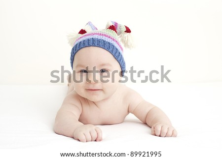 smiling baby with a funny hat