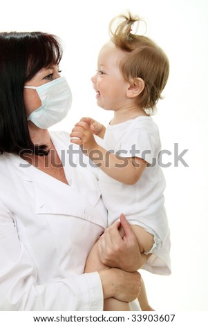 Smiling baby with doctor isolated on white - stock photo