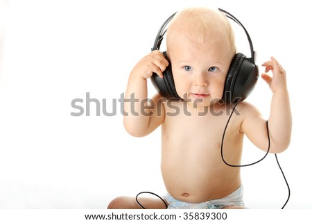 Smiling baby with headphone over white background - stock photo