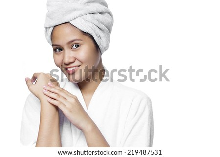 Smiling beautiful asian lady with smooth brown skin.Isolated in white background. - stock photo