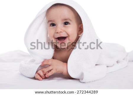 Smiling beautiful baby child with white towel, isolated on white - stock photo