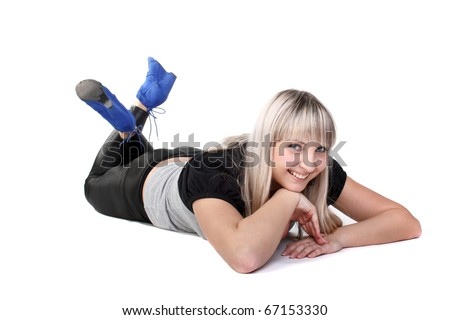 smiling beautiful blond girl lying on the floor
