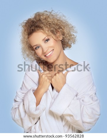Smiling beautiful blond woman in bathrobe