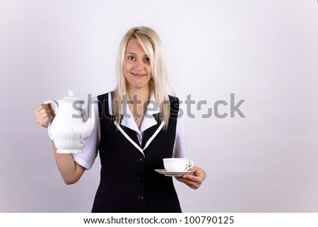 Smiling beautiful blonde girl with a white cup and pot