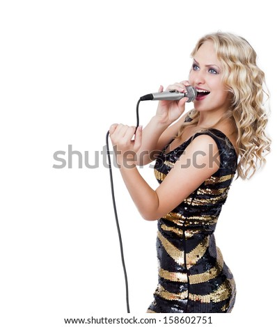 Smiling beautiful blonde woman with microphone isolated on white - stock photo