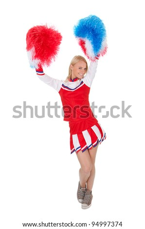 Smiling beautiful cheerleader with pompoms. - stock photo