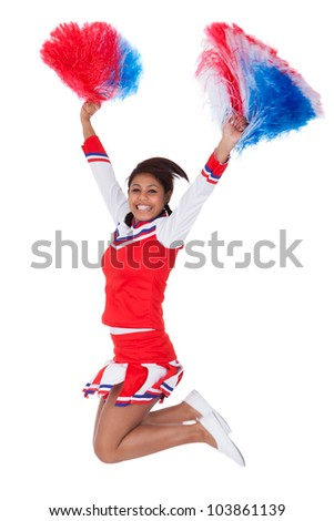 Smiling beautiful cheerleader with pompoms. Isolated on white - stock photo