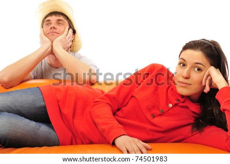 Smiling beautiful couple sitting on a sofa and dreaming about new home