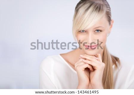 Smiling beautiful female over the white background - stock photo